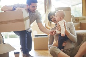 picture of mum holding baby with cardboard boxes for moving home